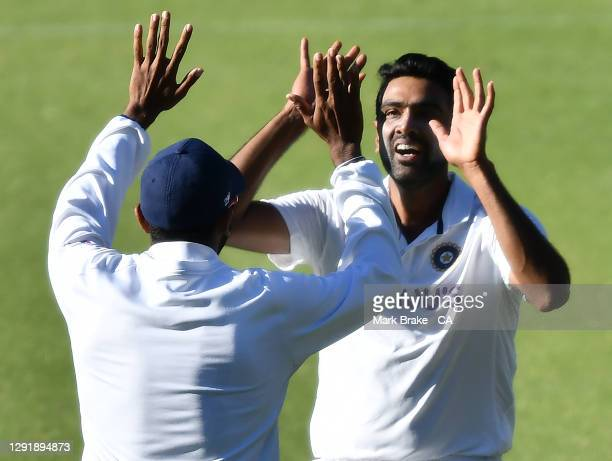 Ravichandran Ashwin of India celebrates the wicket of Travis Head of Australia during day two of the First Test match between Australia and India at...