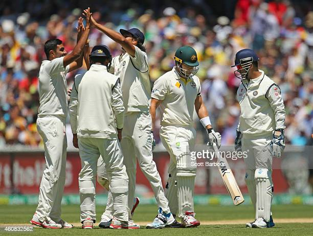 Ravichandran Ashwin of India celebrates with his teammates after dismissing Shane Watson of Australia during day one of the Third Test match between...