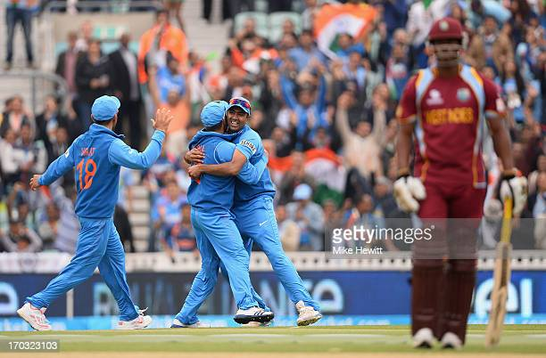 Ravichandran Ashwin of India celebrates with Rohit Sharma and Virat Kohli after taking the catch to dismiss Chris Gayle of the West Indies during the...