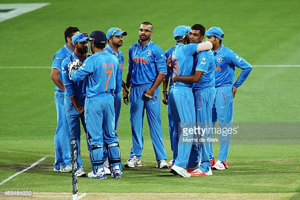 Ravichandran Ashwin of India celebrates with teammates after getting the wicket of Haris Sohail of Pakistan during the 2015 ICC Cricket World Cup...