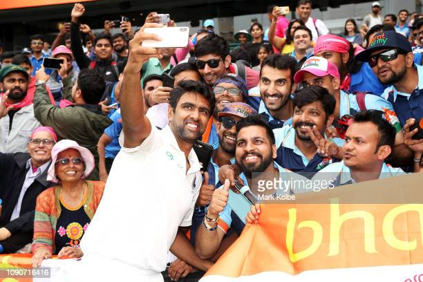 Ravichandran Ashwin of India celebrates with the crowd after India's 21 series win during day five of the Fourth Test match in the series between...