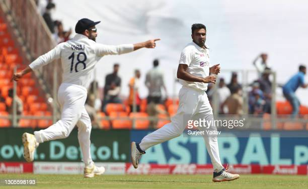 Ravichandran Ashwin of India celebrates with Virat Kohli after taking the wicket of Jonny Bairstow of England during Day Three of the 4th Test Match...