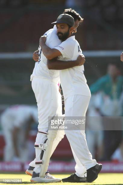 Ravichandran Ashwin of India embraces his captain Ajinkya Rahane of India as they celebrate securing a draw during day five of the Third Test match...