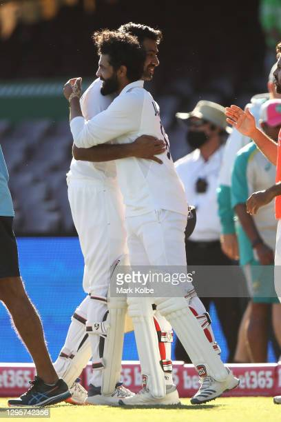Ravichandran Ashwin of India embraces Ravindra Jadeja of India as they celebrate securing a draw during day five of the Third Test match in the...