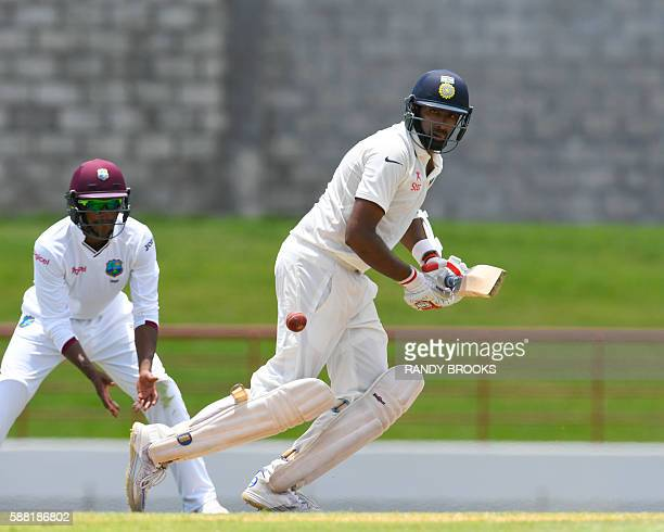 Ravichandran Ashwin of India hits 4 during day 2 of the 3rd Test between West Indies and India on August 10 2016 at Darren Sammy National Cricket...