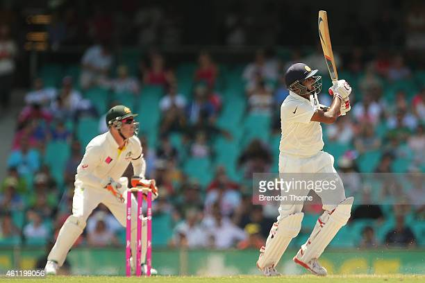 Ravichandran Ashwin of India hits for six during day four of the Fourth Test match between Australia and India at Sydney Cricket Ground on January 9...