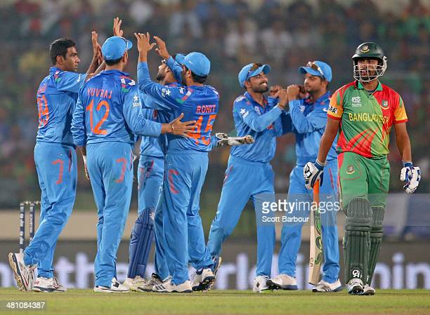 Ravichandran Ashwin of India is congratulated by his teammates after dismissing Tamim Iqbal of Bangladesh during the ICC World Twenty20 Bangladesh...
