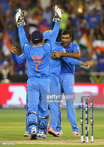 Ravichandran Ashwin of India is congratulated by team mates after taking the wicket of JP Duminy of South Africa during the 2015 ICC Cricket World...