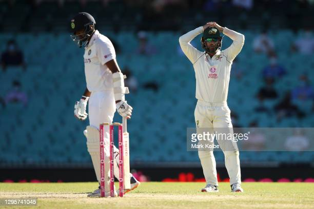 Ravichandran Ashwin of India walks away as Matthew Wade of Australia shows his frustration during day five of the Third Test match in the series...