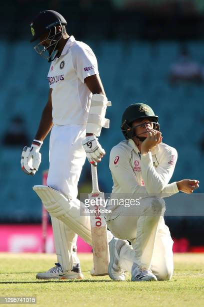 Ravichandran Ashwin of India walks away as Sean Abbott of Australia shows his frustration during day five of the Third Test match in the series...