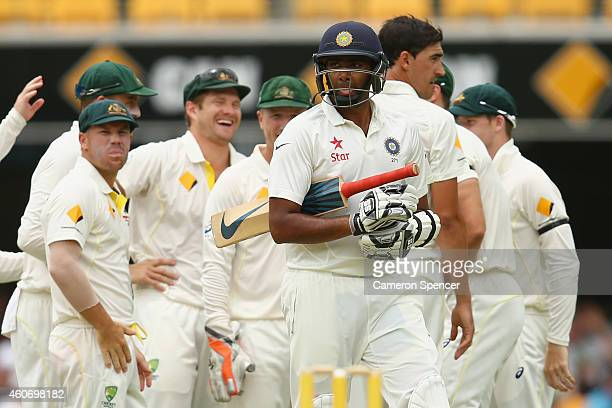 Ravichandran Ashwin of India walks off the field after being dismissed by Mitchell Starc of Australia during day four of the 2nd Test match between...