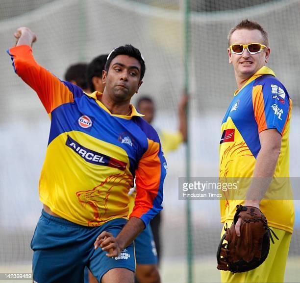 Ravichandran Ashwin of the Chennai Super Kings bowls as his teammate Scott Styris looks on during net practice at MA Chidambaram Stadium on April 2...