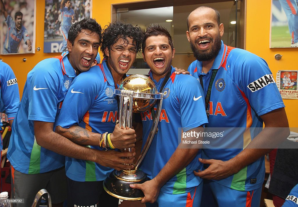 Ravichandran Ashwin (L),Shanthakumaran Sreesanth (2L),Suresh Raina (2R) and Yusuf Pathan (R) pose with the world cup trophy in the players dressing room after their six wicket victory in the 2011 ICC World Cup Final between India and Sri Lanka at Wankhede Stadium on April 2, 2011 in Mumbai, India.
