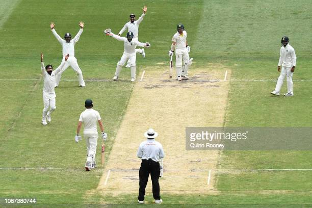 Ravindra Jadeja and his Indian team mates appeal for a lbw against Travis Head of Australia during day three of the Third Test match in the series...