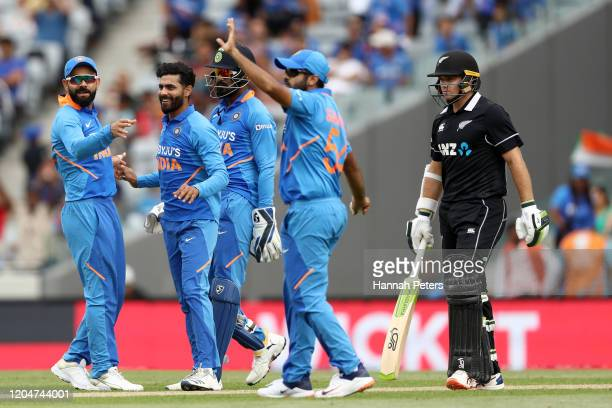 Ravindra Jadeja and India celebrates the wicket of Tom Latham of the Black Caps during game two of the One Day International Series between New...