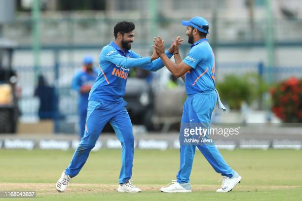 Ravindra Jadeja and Rohit Sharma celebrate the wicket of Shai Hope of the West Indies during the third MyTeam11 ODI between the West Indies and India...