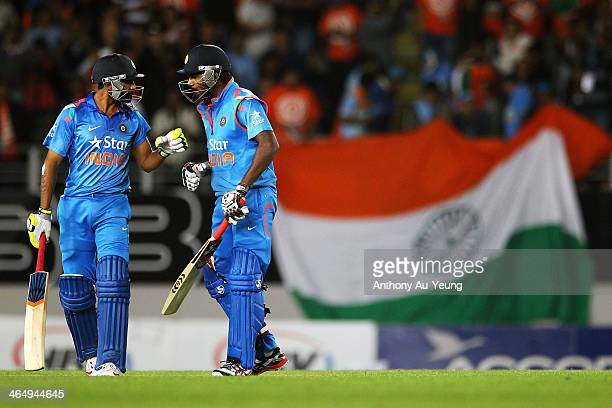 Ravindra Jadeja and Varun Aaron of India prepare for the last ball during the One Day International match between New Zealand and India at Eden Park...