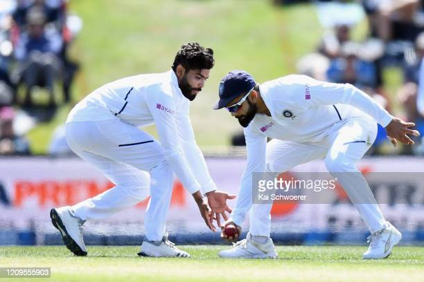 Ravindra Jadeja and Virat Kohli of India field the ball during day two of the Second Test match between New Zealand and India at Hagley Oval on March...
