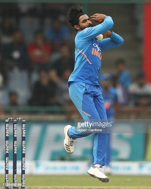 Ravindra Jadeja of India bowls during game five of the One Day International series between India and Australia at Feroz Shah Kotla Ground on March...