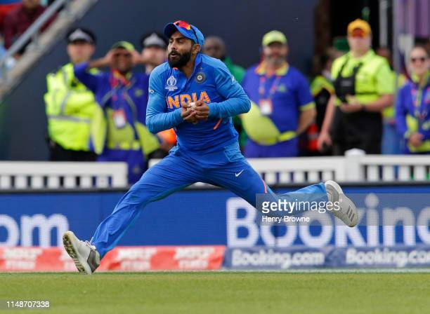 Ravindra Jadeja of India catches out Glenn Maxwell of Australia during the Group Stage match of the ICC Cricket World Cup 2019 between India and...