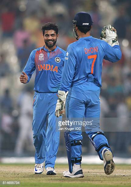 Ravindra Jadeja of India celebrates a wicket with MS Dhoni Captain of India during the ICC World Twenty20 warm up match between India and West Indies...