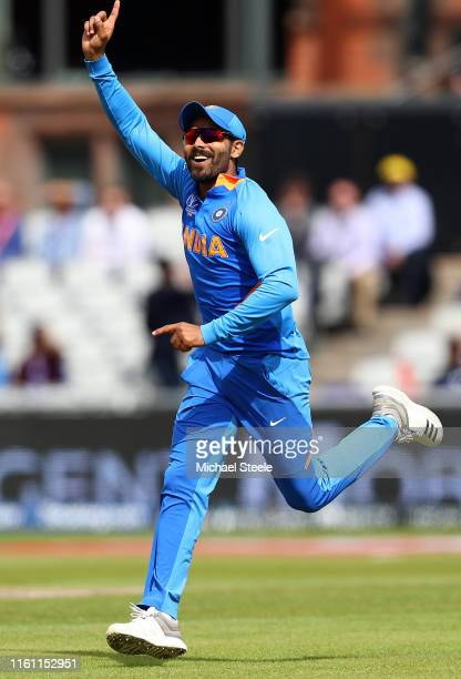 Ravindra Jadeja of India celebrates after running out Ross Taylor of New Zealand with a direct hit to the stumps during resumption of the SemiFinal...