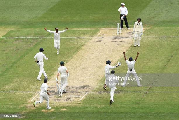 Ravindra Jadeja of India celebrates taking the wicket of Marcus Harris of Australia during day four of the Third Test match in the series between...