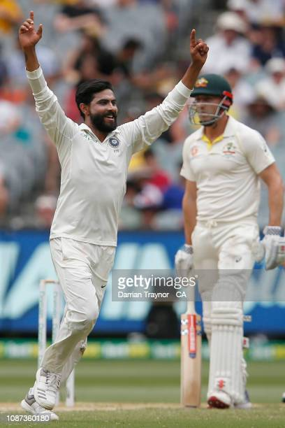Ravindra Jadeja of India celebrates the wicket of Usman Khawaja of Australia during day three of the Third Test match in the series between Australia...