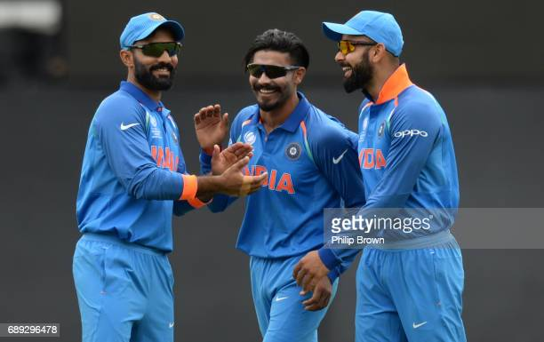 Ravindra Jadeja of India celebrates with Virat Kohli and Dinesh Karthik after dismissing Colin de Grandhomme of New Zealand during the ICC Champions...