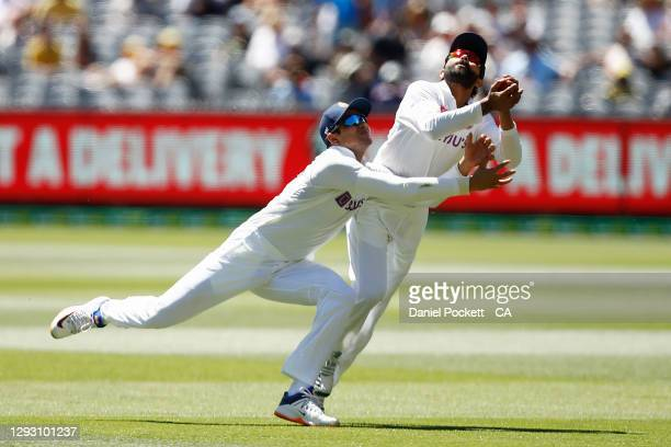 Ravindra Jadeja of India collides with Shubman Gill of India as he catches out Matthew Wade of Australia during day one of the Second Test match...