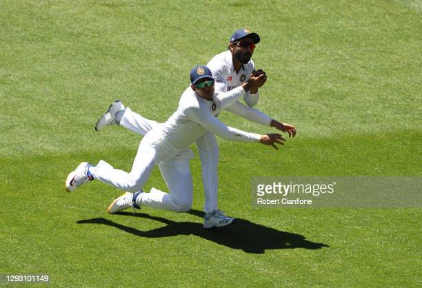 Ravindra Jadeja of India collides with team mate Shubman Gill as he takes a catch to dismiss Matthew Wade of Australia during day one of the Second...