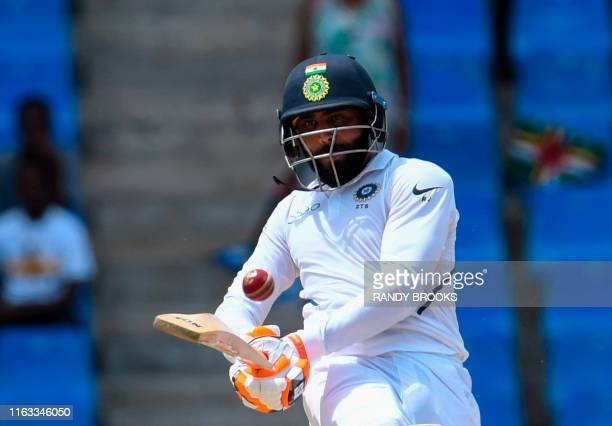 Ravindra Jadeja of India hits 4 during day 2 of the 1st Test between West Indies and India at Vivian Richards Cricket Stadium in North Sound Antigua...