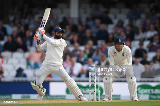 Ravindra Jadeja of India hits out as wicketkeeper Jonny Bairstow of England look on during the Specsavers 5th Test Day Three between England and...