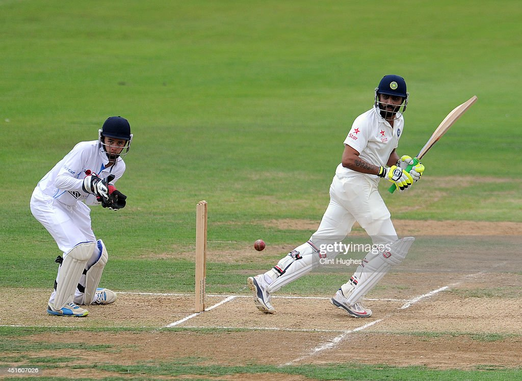 Ravindra Jadeja (R) of India in action during day two of the tour match between Derbyshire and India at The 3aaa County Ground on July 2, 2014 in Derby, England.