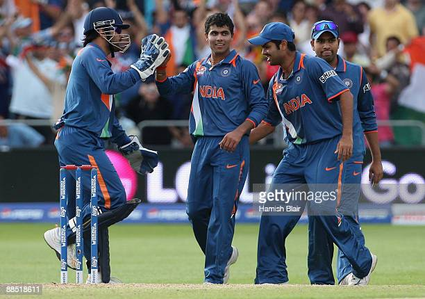 Ravindra Jadeja of India is congratulated by his team mates after taking the wicket of AB de Villiers of South Africa during the ICC World Twenty20...