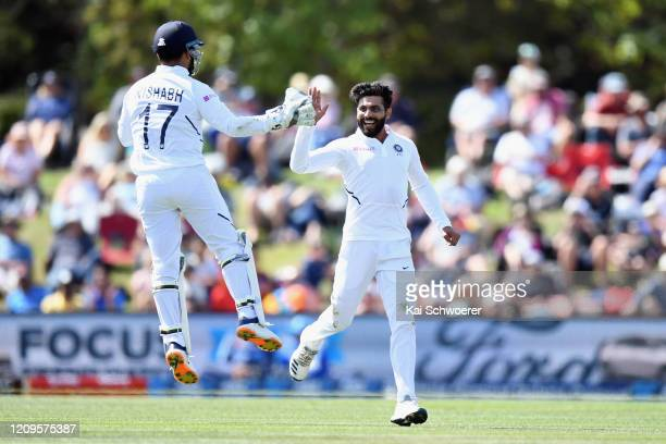 Ravindra Jadeja of India is congratulated by Rishabh Pant of India after dismissing Colin de Grandhomme of New Zealand during day two of the Second...