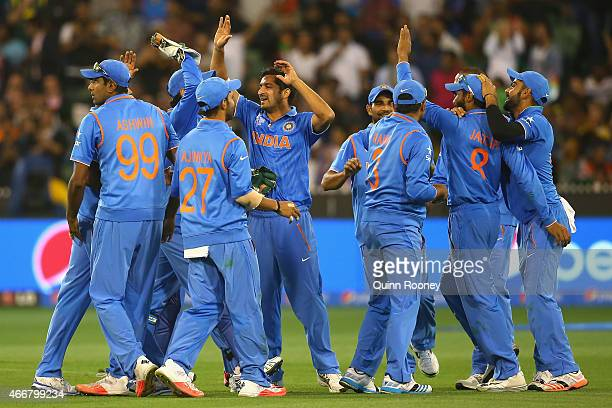 Ravindra Jadeja of India is congratulated by team mates after running out Imrul Kayes of Bangladesh during the 2015 ICC Cricket World Cup Quater...