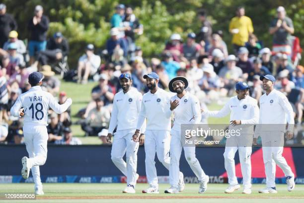 Ravindra Jadeja of India is congratulated by team mates after taking a catch to dismiss Neil Wagner of New Zealand during day two of the Second Test...