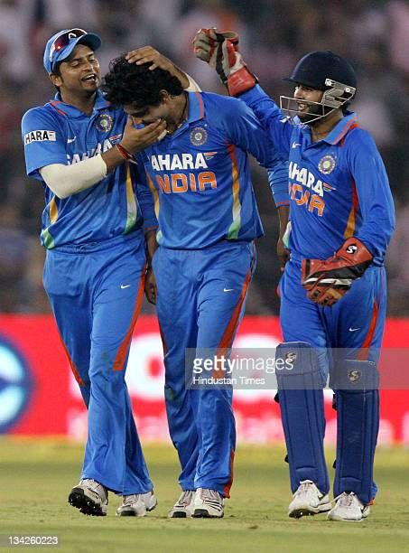 Ravindra Jadeja of India is congratulated by teammates Suresh Raina and Parthiv Patel after taking the wicket of West Indies captain Darren Sammy...