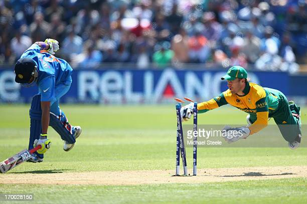 Ravindra Jadeja of India makes his ground as AB de Villiers of South Africa attempts a run out during the Group B ICC Champions Trophy match between...