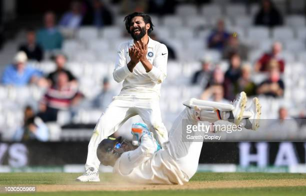 Ravindra Jadeja of India reacts after wicketkeeper Rishabh Pant fails to catch the ball during day four of the Specsavers 5th Test match between...
