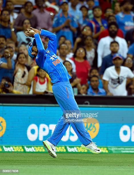 Ravindra Jadeja of India takes a catch during the first Twenty20 cricket international between India and Australia at the Adelaide Oval in Adelaide...