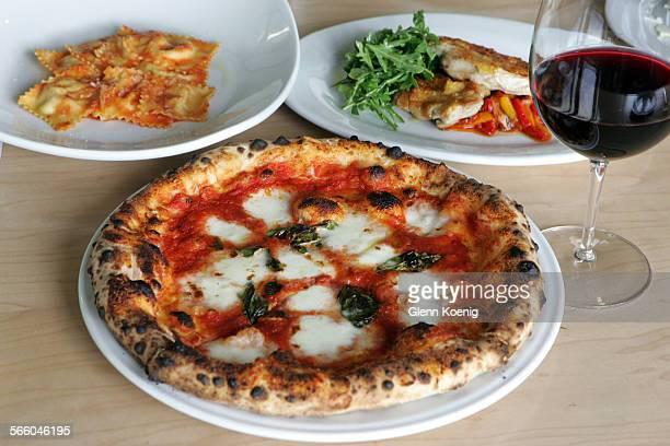 Ravioli di burrata, Pollo al mattone and the pizza margherita, as served at Pizzeria Ortica in Costa Mesa on April 9, 2009 .The restaurant is long...