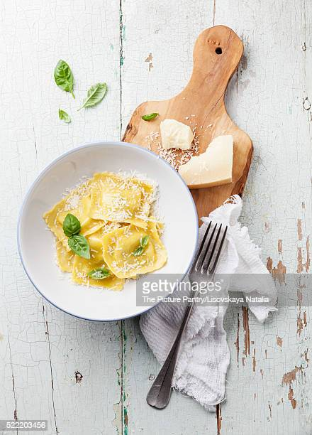 Ravioli pasta with cream sauce, basil and parmesan cheese on oli