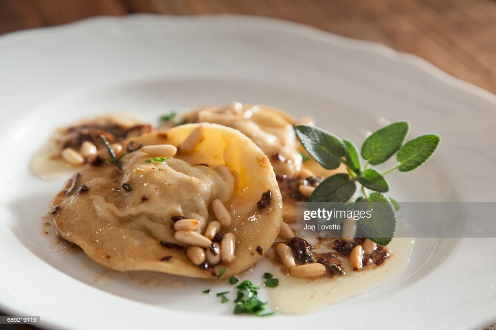 Ravioli with sage and butter : Stock Photo