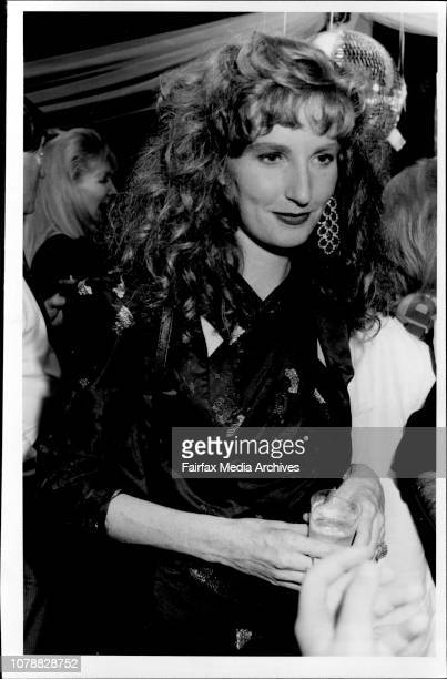 Ravishing redhaired model Angela Dunn who's off to the catwalks of Paris soon Christmas partying at the Woollahra sailing club December 16 1986