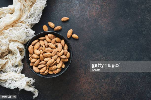 raw almonds in bowl - almond stock pictures, royalty-free photos & images