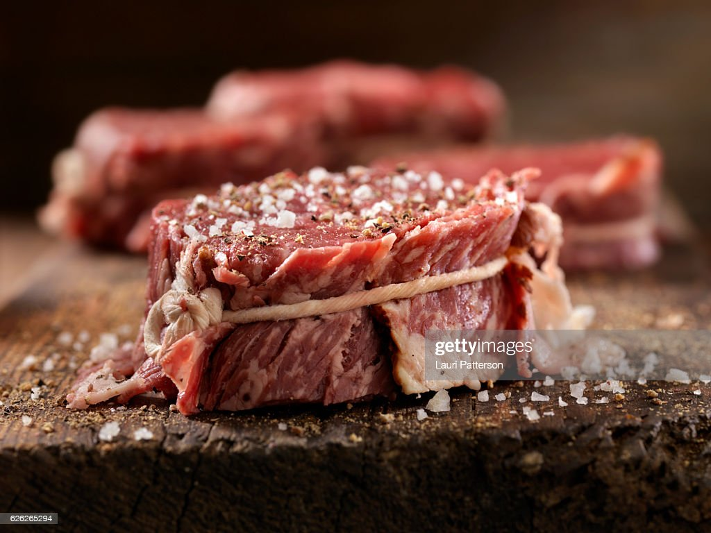 Raw Bacon Wrapped Steak Fillets Seasoned with Salt and Pepper : Stock Photo