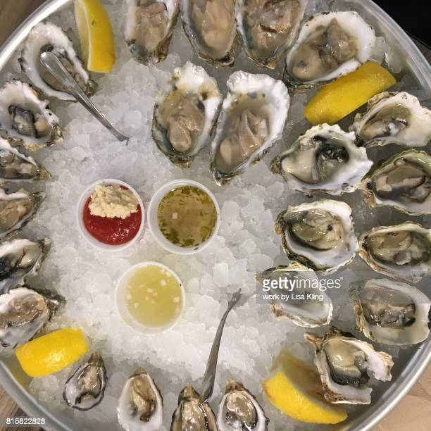 Raw Bar oyster platter served on ice