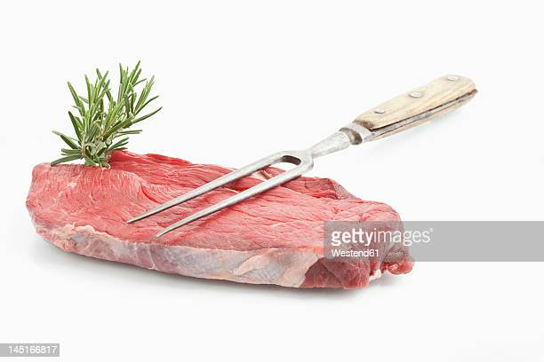Raw beef on white background, close up